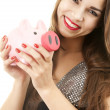 Young woman holding piggybank — Stock Photo