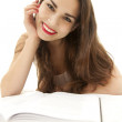 Smiling young student woman with book - Stock Photo