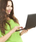 Cheerful woman working on laptop — Stock Photo