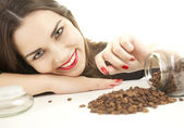 Smiling girl with coffee beans — Stock Photo