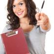 Pointing student girl with clipboard — Stockfoto