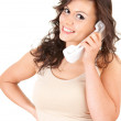 Smiing girl speaking on the phone — Stock Photo