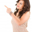 Casual woman pointing up — Stock Photo