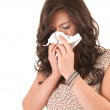 Woman with a runny nose - Stock Photo