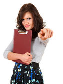 Pointing angry woman with clipboard — Foto de Stock