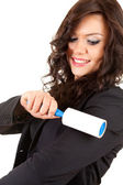 Woman cleaning dust with lint roller — Stock Photo