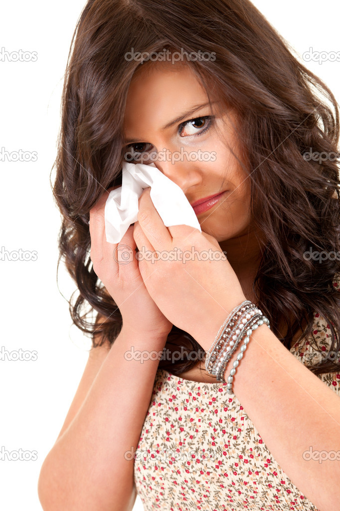 Crying teenage girl with handkerchief, white background — Stock Photo #10055744