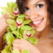Beautiful girl with flowers — Stock Photo #10064543