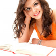 Stock Photo: Smiling young student womwith book