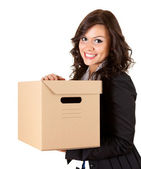Businesswoman keeping cardboard box — Stock Photo