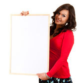 Young woman with blank billboard — Stock Photo