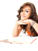 Smiling young student woman with book — Stock Photo