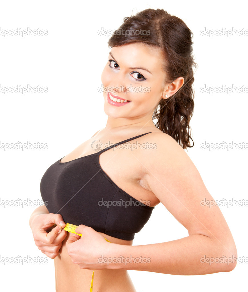 Young woman measuring her under breasts, white background — Stock Photo #10064568