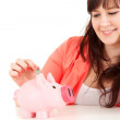 Fat teenage girl with piggy bank — Stock Photo