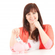 Overweight teenage girl and piggy bank — Stock Photo