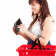 Smiling shopping girl with wallet — Stock Photo