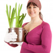 Pregnant woman with plant in pot — Stock Photo