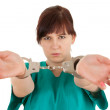 Frightened lady doctor in handcuffs — Stock Photo