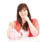 Overweight teenage girl and piggy bank — Stock Photo