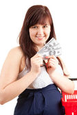 Pregnant shopping woman with dolars — Stock Photo