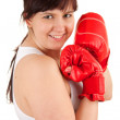 Young woman wearing boxing gloves — Stock Photo