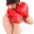 Girl wearing boxing gloves — ストック写真
