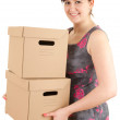 Young woman keeping boxes - Stock Photo