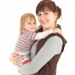Young mother cuddling son — Stock Photo