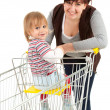 Baby son with mother taking shopping — Stock Photo