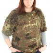 Angry young woman in camouflage shirt — Stock Photo