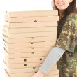 Young woman with boxes of pizza — Stock Photo #10574682