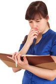 Frightened young woman with book — Stock Photo