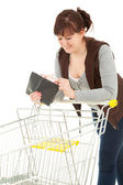 Shopping girl with wallet — Stock Photo