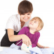 Housework - mother ironing with daughter — Stock Photo