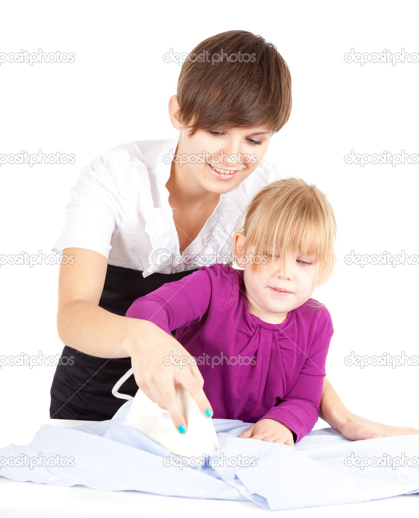 Housework - young mother ironing with little daughter  Stock Photo #9371098