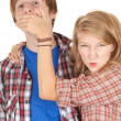Angry girl covering her boyfriend mouth — Stock Photo #9464463