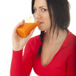 Young woman drinking juice — Stock Photo #9464676