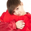 Girl hugging big red heart pillow — Stock Photo #9464706