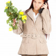Furious calling girl with flowers — Stock Photo