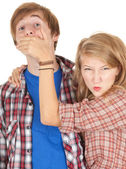 Angry girl covering her boyfriend mouth — Stock Photo