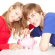 Stock Photo: Teenage couple and piggy bank