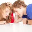 Tired teenage student couple — Stock Photo