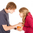 Halloween - young couple with pumpkin — Stock Photo