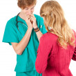 Male doctor examining young woman - Stock Photo