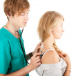 Male doctor examining young woman — Stock Photo