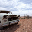 Stock Photo: Rusty wrecked car in Outback Australia