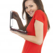 Stock Photo: Smiling young womwith laptop