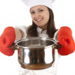 Chef lady in gloves keeping steel pot — Stock Photo