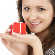 Stock Photo: Smiling girl with red gift box