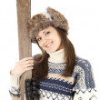 Young woman with old wooden skis - Stock Photo